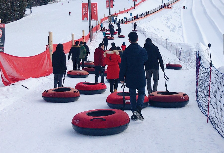 people in line to go snow tubing