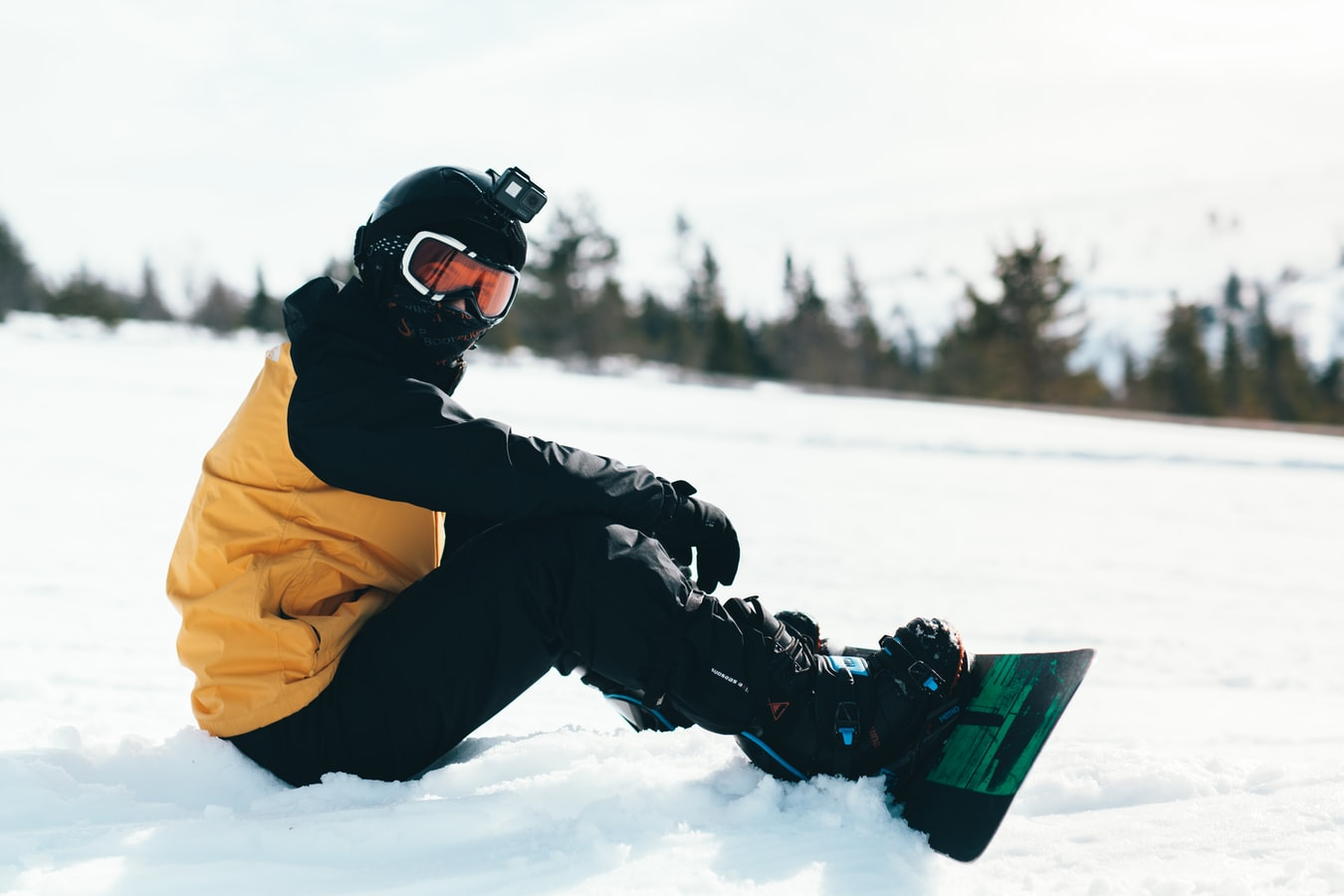 snowboarder sitting on the slopes