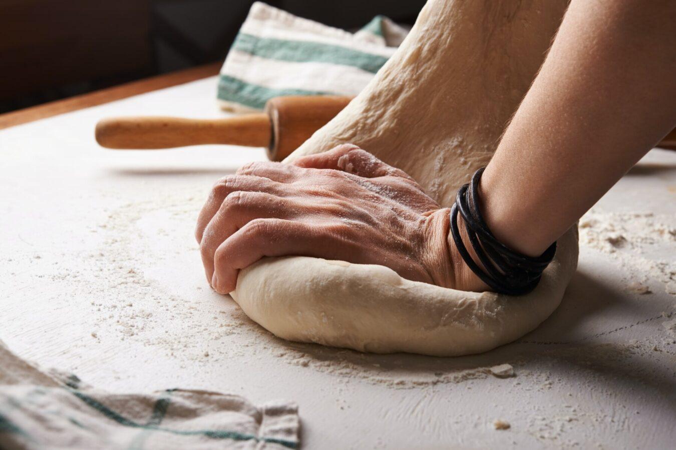 Pizza maker kneading dough