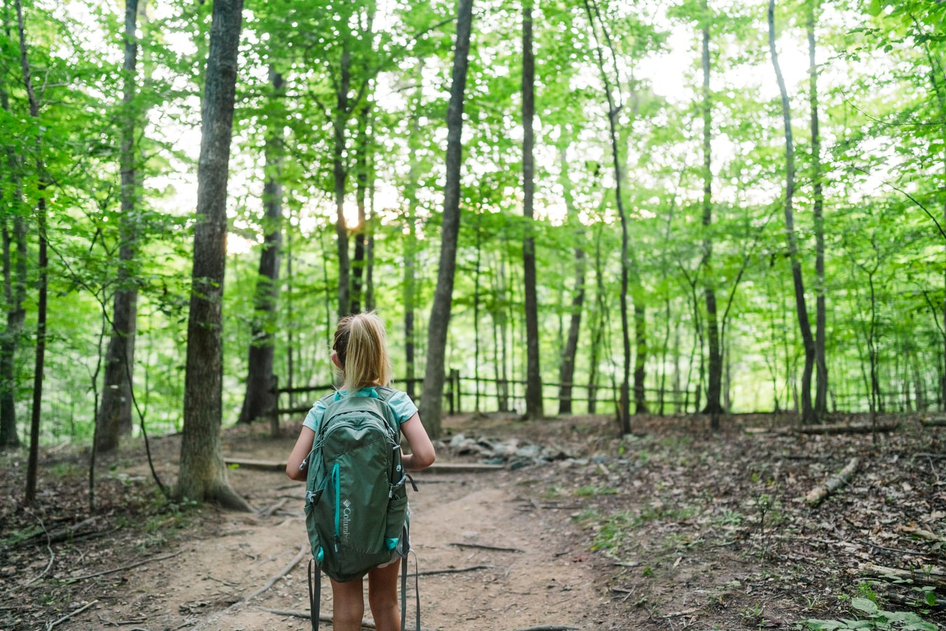 girl hiking in the woods