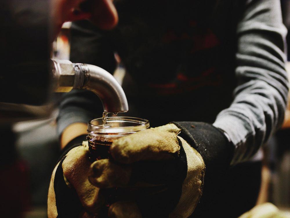 person making maple syrup in killington, ermont