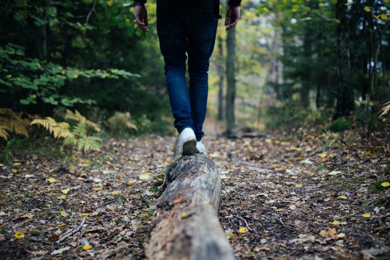 person walking on a log in killington